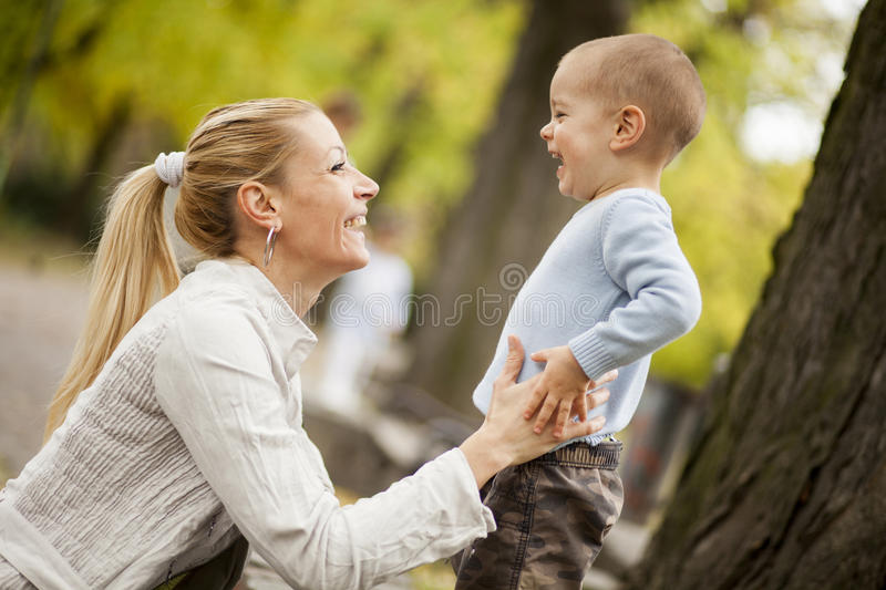Mother and son in the autumn forest royalty free stock image