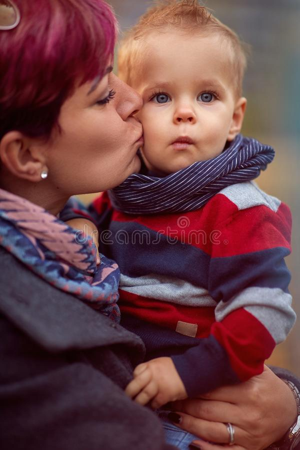 Mother with son at the autumn park enjoying together royalty free stock images