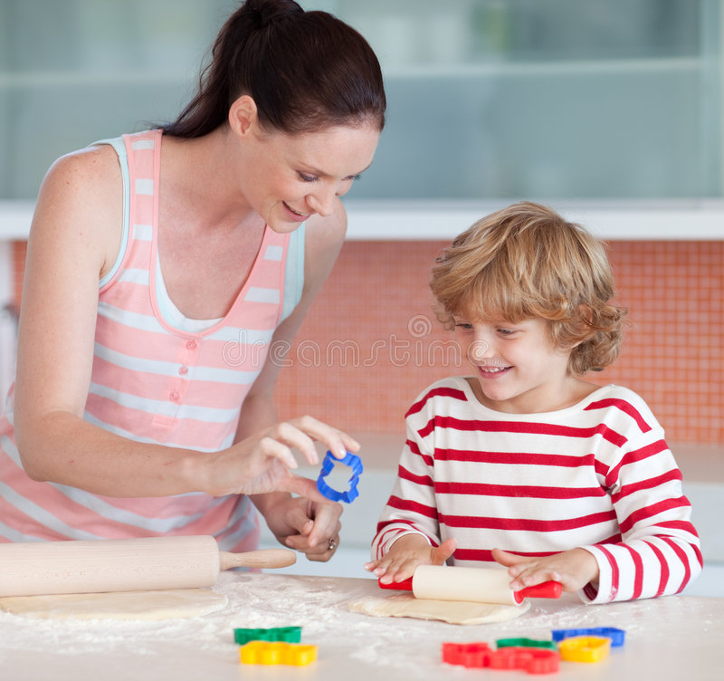 Download Mother And Son Baking In The Kitchen Stock Photo - Image: 9098342
