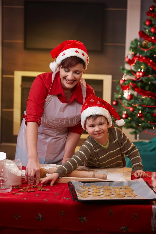 Download Mother And Son Baking Together For Christmas Stock Photo - Image: 27468556