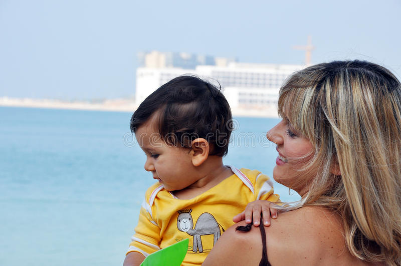 Mother and son on beach stock photo