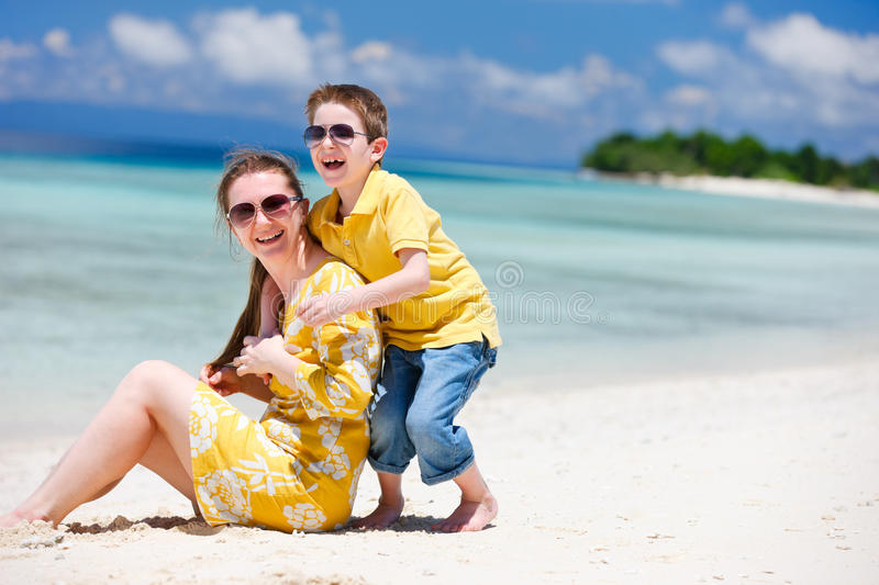 Mother And Son At Beach Stock Photos