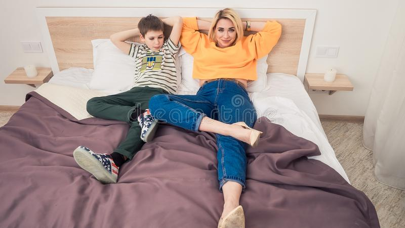 Mother with son on bed stock photos