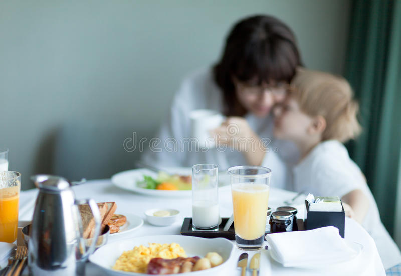 Mother and son at breakfast - out of focus royalty free stock photos