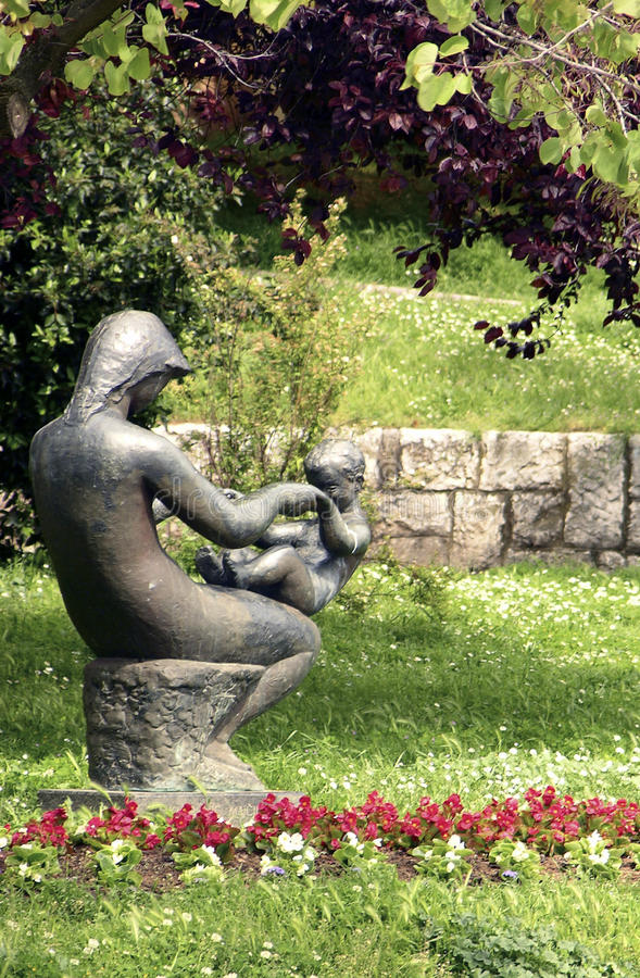 Mother and son bronze statue in Porec,Croatia royalty free stock image