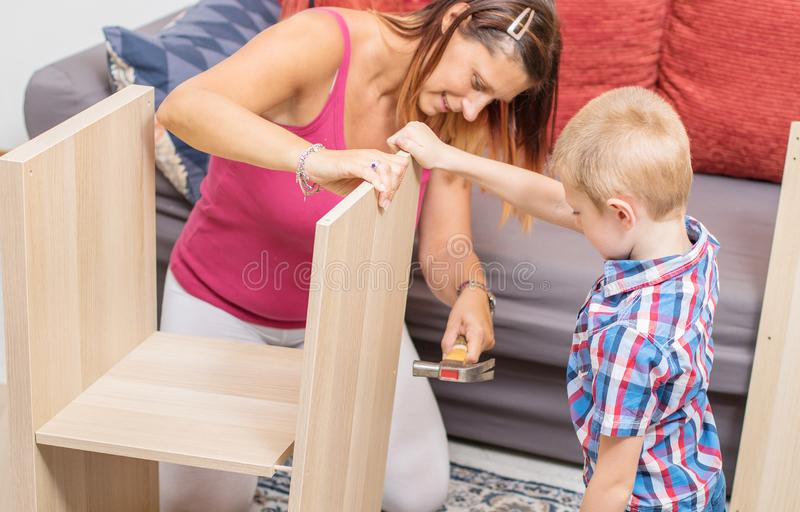 Mother and son are building the furniture royalty free stock photography