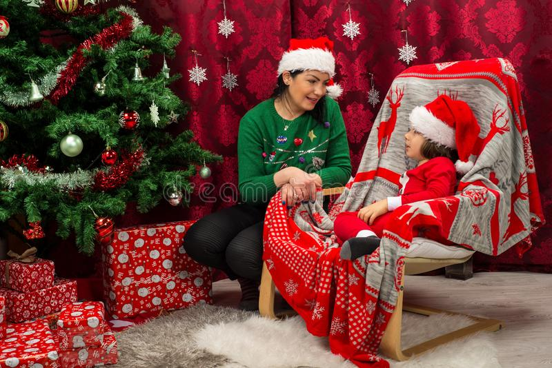Mother and son in Christmas clothes talking royalty free stock photography