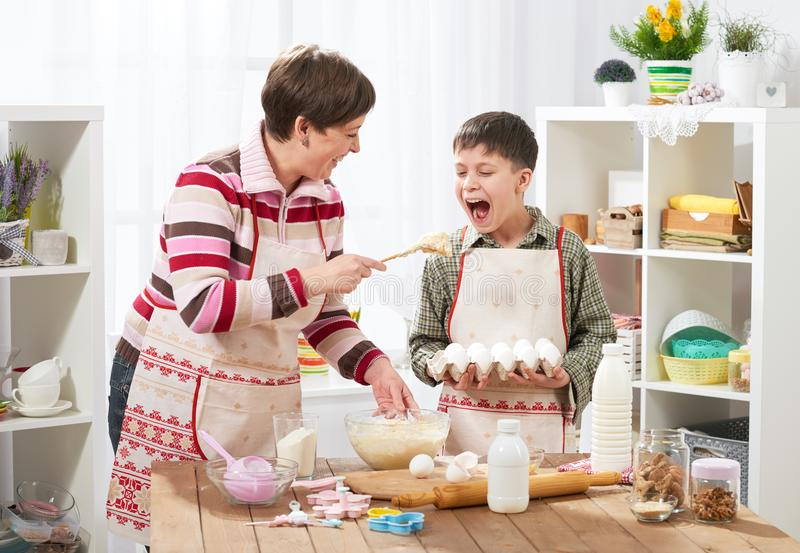 Mother and son cooking at home. Happy family. Healthy food concept royalty free stock photography