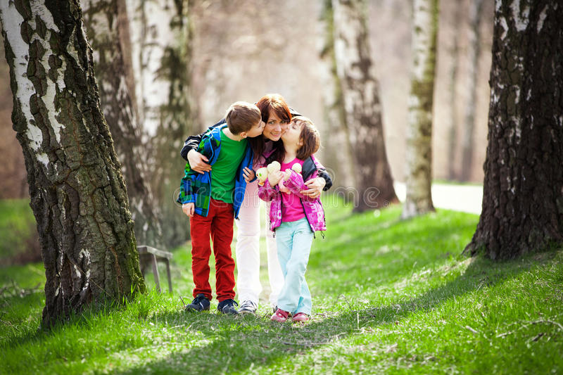 Mother with son and daughter in woods stock photo