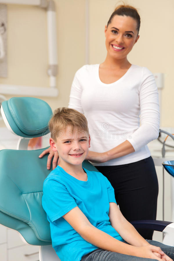 Mother son dentist's office royalty free stock images