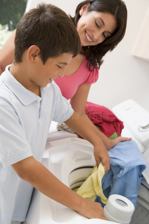 Download Mother And Son Doing Laundry Stock Image - Image: 6881701