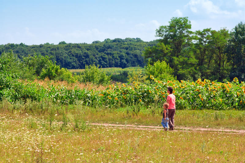 Mother And Son In A Flower Meadow Royalty Free Stock Photo