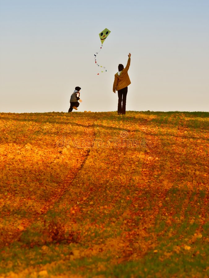 Mother and son fly a kite stock images