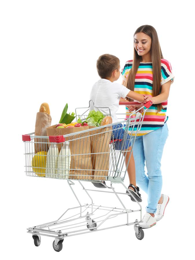 Mother and son with full shopping cart on background royalty free stock images