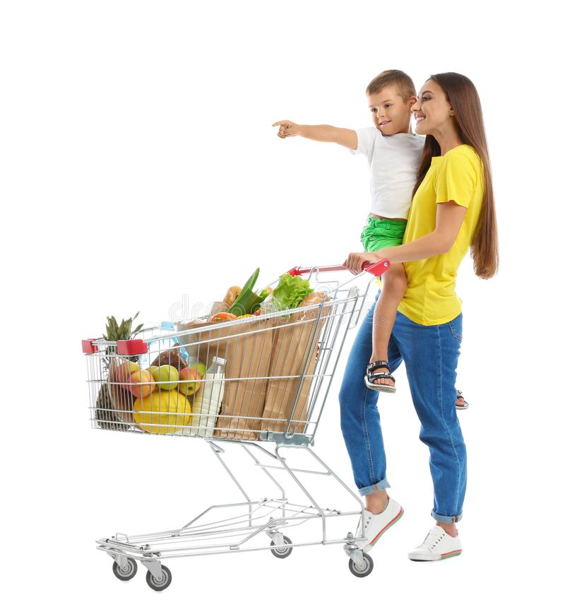 Mother and son with full shopping cart on background stock image