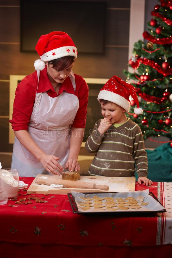 Mother and son getting ready for christmas. Mother and small son getting ready for christmas, baking cake together stock photos