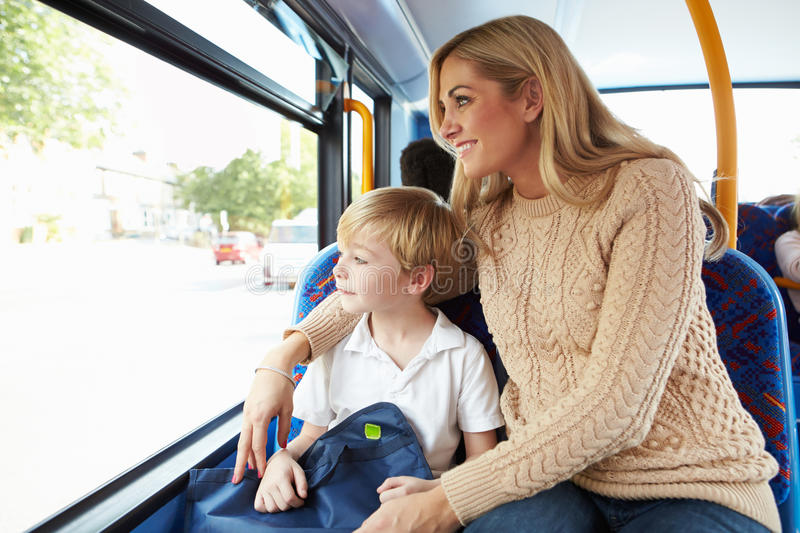 Mother And Son Going To School On Bus Together royalty free stock image