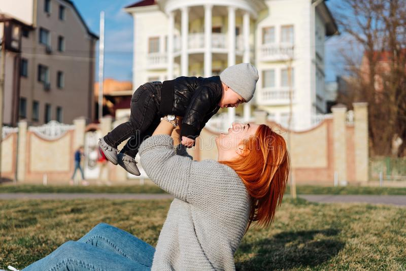 Mother and son on the grass stock photography