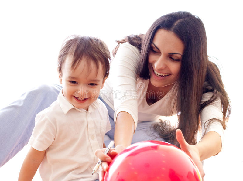 Mother and son have fun with red balloon together