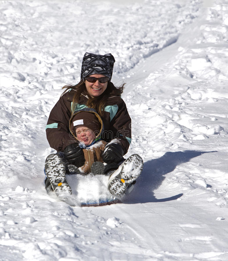 Download Mother And Son Having Fun On The Sled Hill Stock Image - Image: 28455997