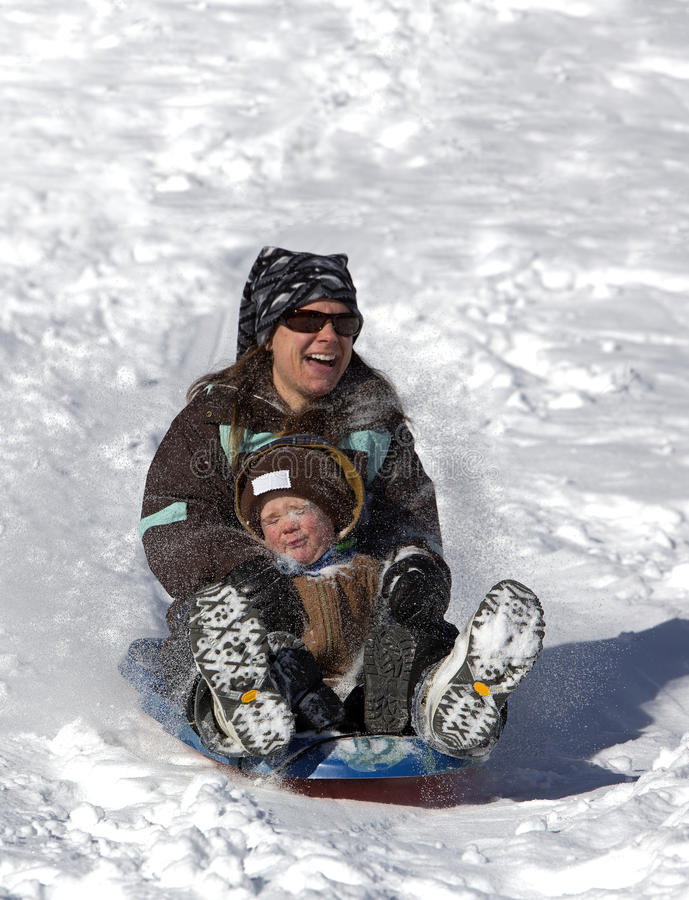 Mother And Son Having Fun On The Sled Hill Stock Image