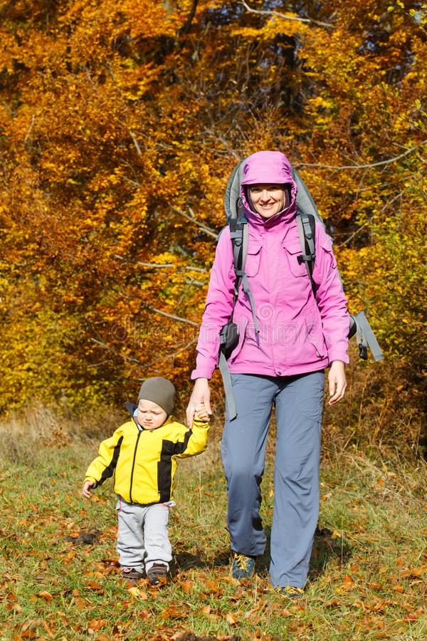 Mother with son hiking on a nice autumn day royalty free stock photos