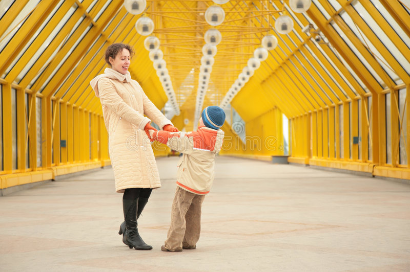 Download Mother And Son Hold Each Other For Hands Stock Photo - Image: 5451696