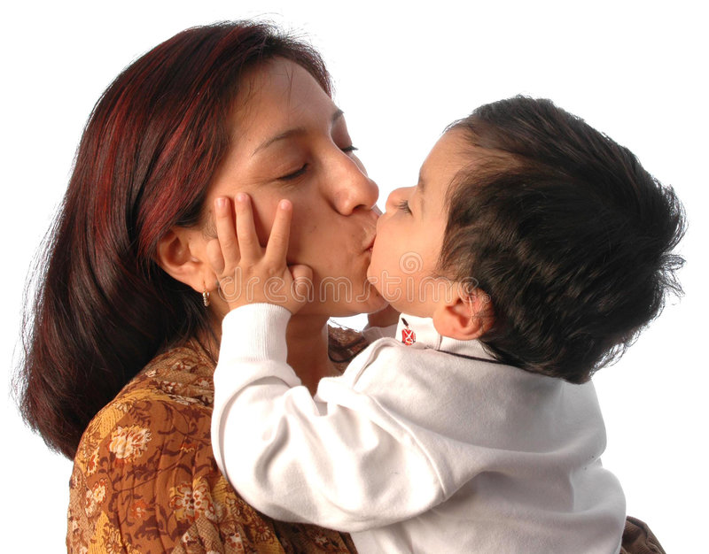 Mother and son kissing. A hispanic woman and her young son kissing