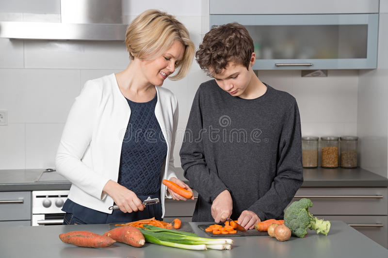 Mother and Son in the kitchen stock photo
