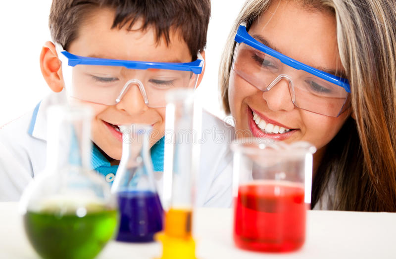 Download Mother and son at the lab stock image. Image of background - 24900685