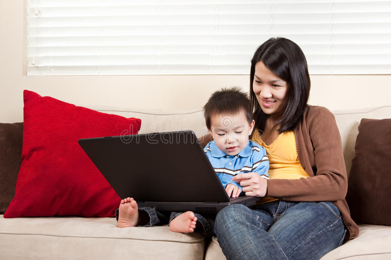 Mother and son with laptop stock images