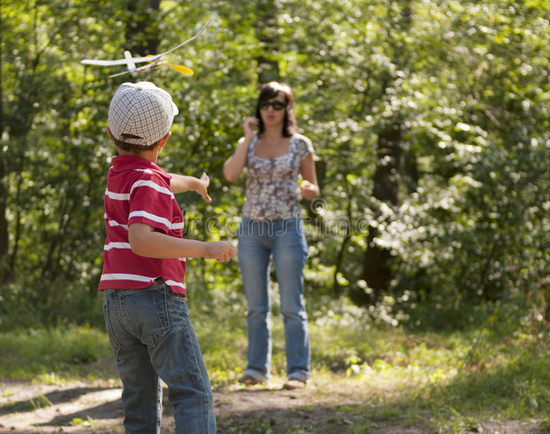 Download Mother And Son Launching Toy Glider Stock Image - Image of outdoors, enjoy: 21001977
