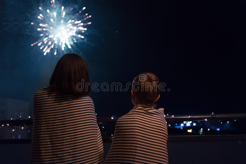 Mother and son looking at New Year celebration fireworks in nigh stock photos