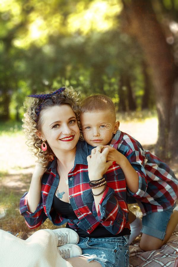 Mother and son lovely portrait together hugging stock photo