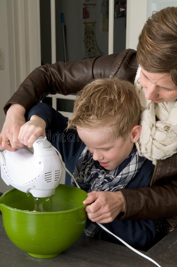 Download Mother And Son Mixing The Dough Stock Photo - Image: 18669020