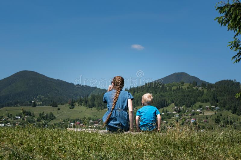 Mother and son on mountains background. Travel with small child stock image