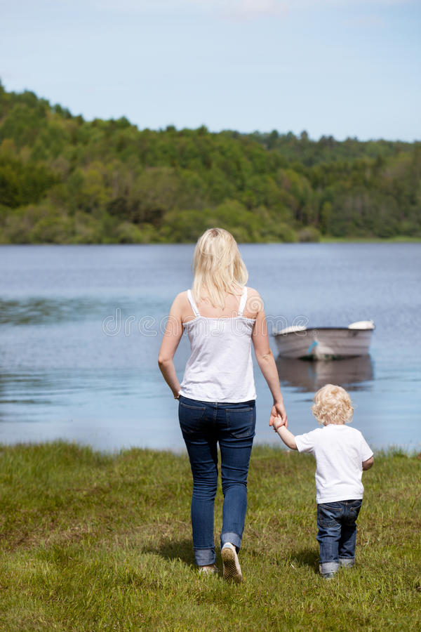 Mother with Son near Lake stock photo