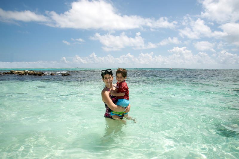 Download Mother And Son In The Ocean Stock Image - Image of vacations, ocean: 16272797