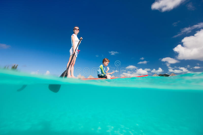 Mother and son paddling. On stand up paddle board