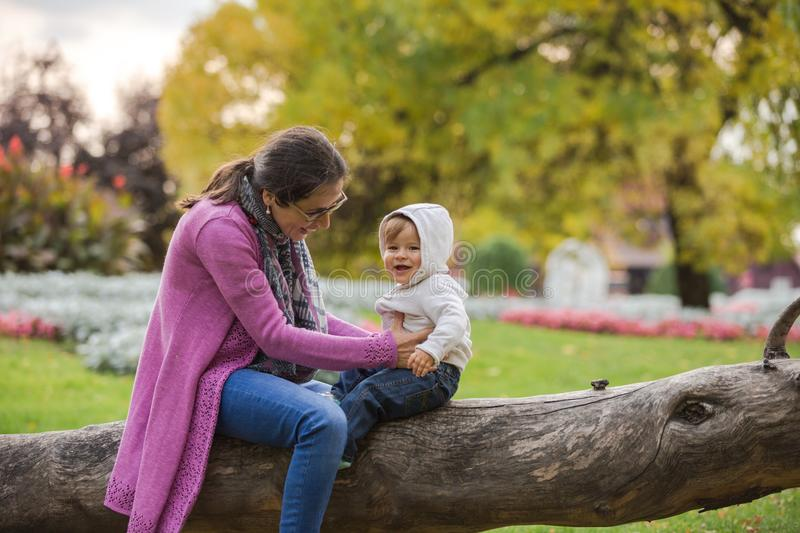 Mother and son at park royalty free stock photo