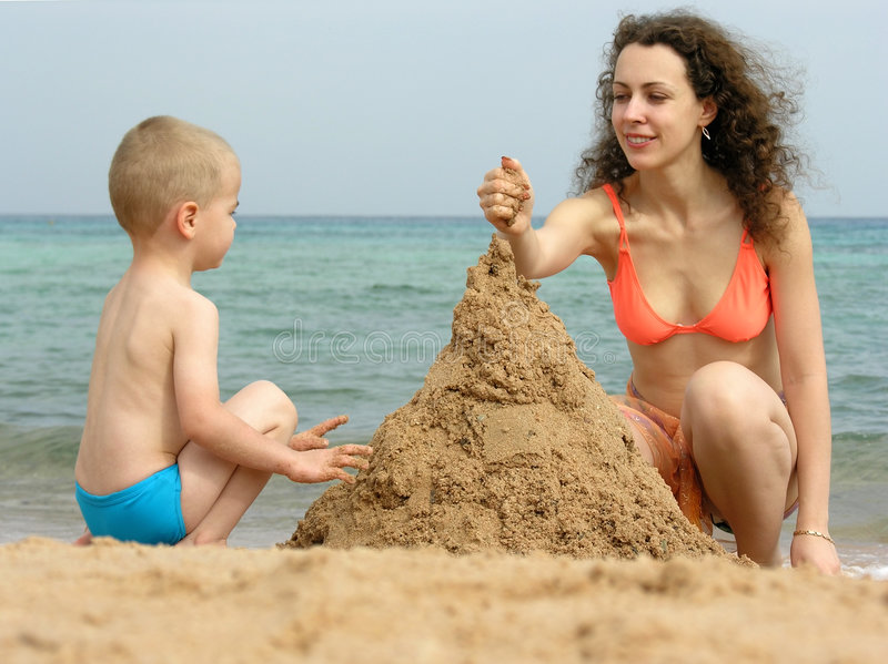 Download Mother With Son Play On Beach Stock Photo - Image of castle, hurgada: 445982
