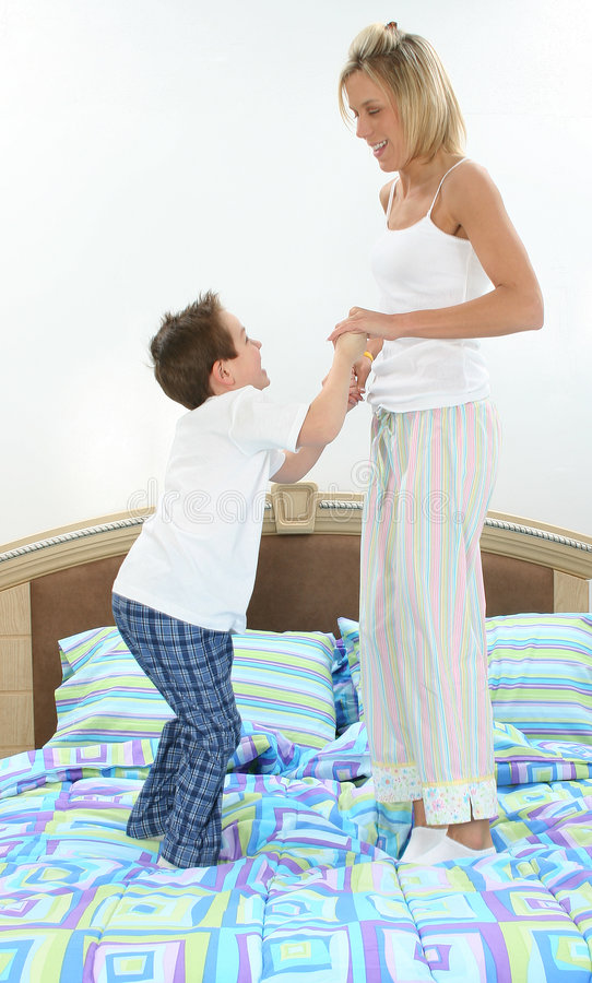 mother and son playing in bed stock photos image 499293. Black Bedroom Furniture Sets. Home Design Ideas