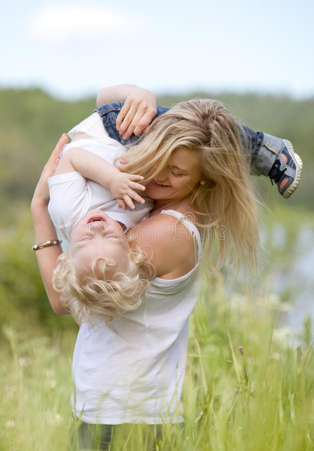 Mother and Son Playing in Meadow stock image