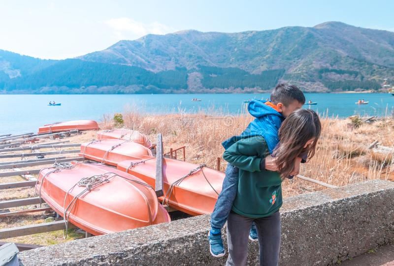 Mother and Son playing near Ashi Lake in Hakone, Japan stock photo