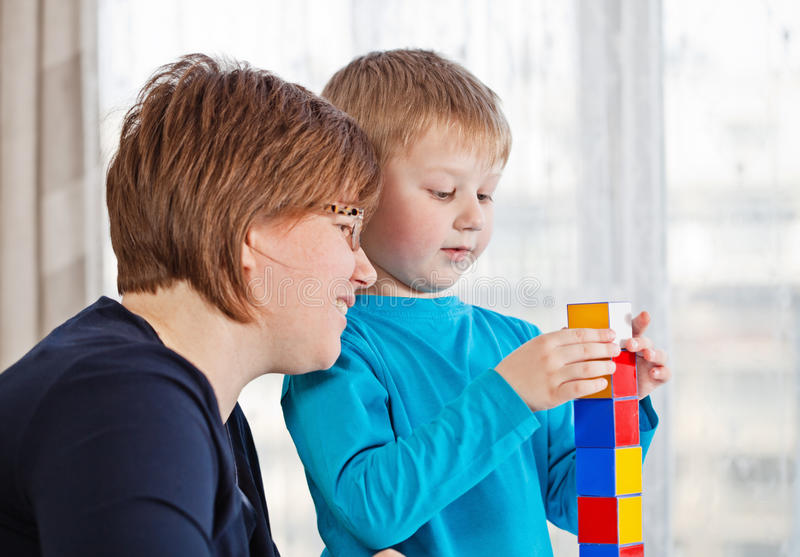 Mother and son playing together stock photography