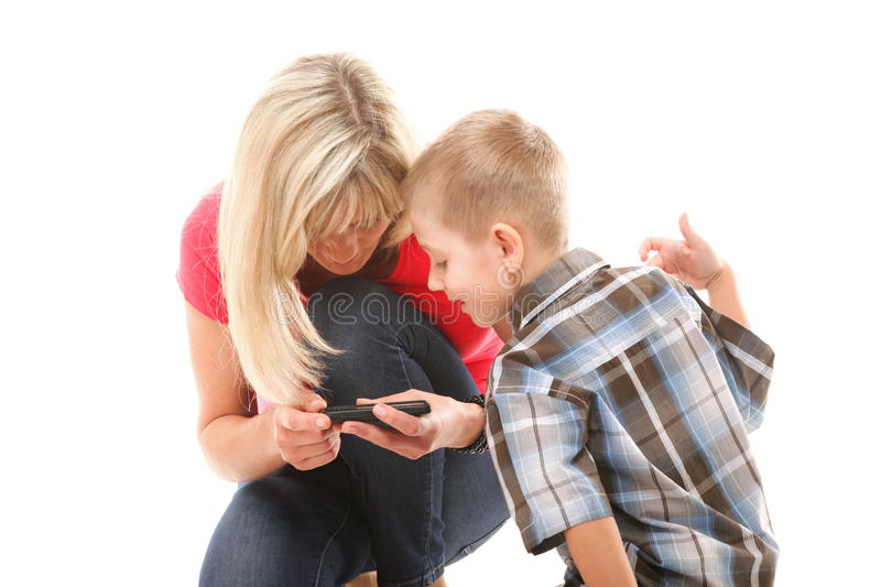 Download Mother And Son Playing Video Game On Smart Phone Stock Photo - Image: 34082820