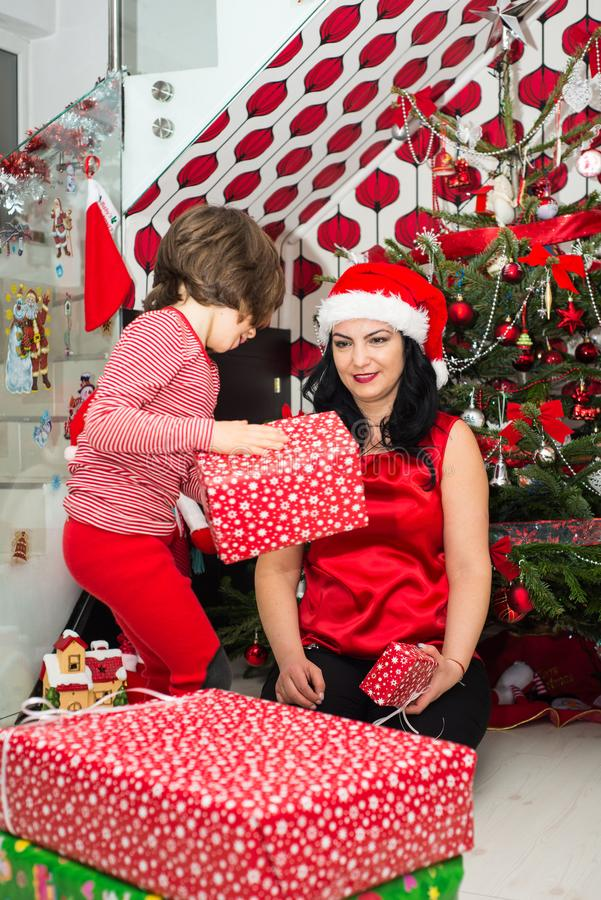 Mother and son prepare for Christmas. And wrapping their presents royalty free stock photo