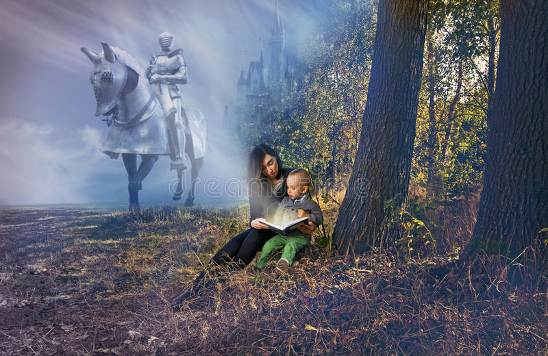 Mother and son reading fairy tales. stock image