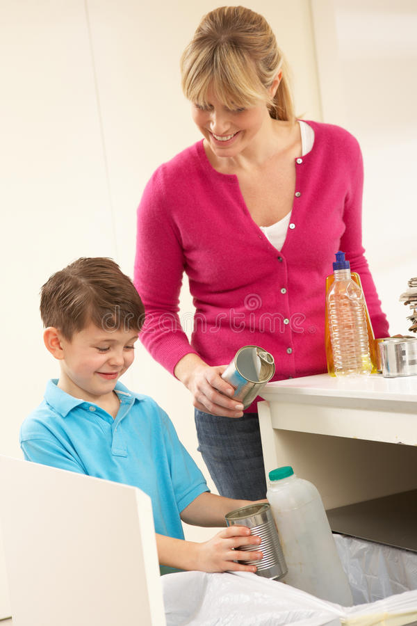 Download Mother And Son Recyling Waste At Home Stock Photo - Image: 18745394