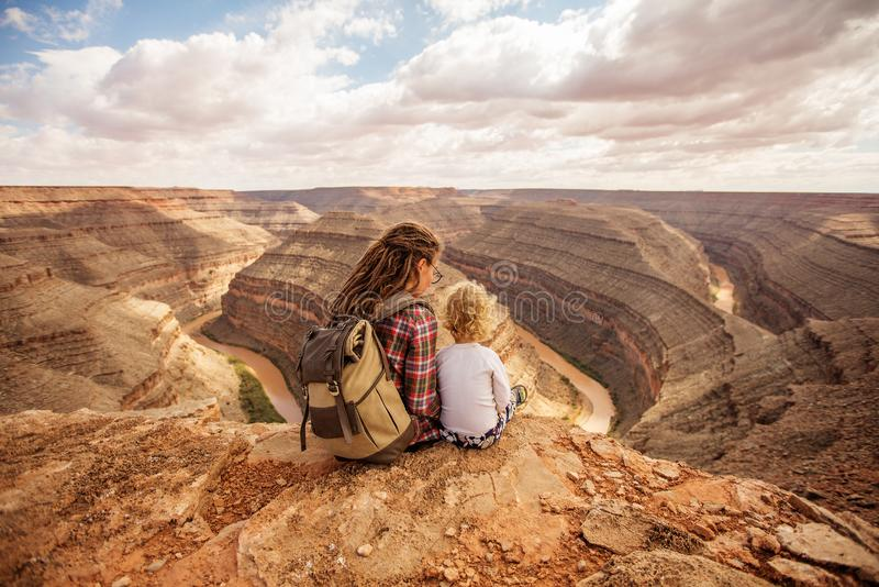 Mother with son relax in Goosenecks state Park,  USA.  royalty free stock photography
